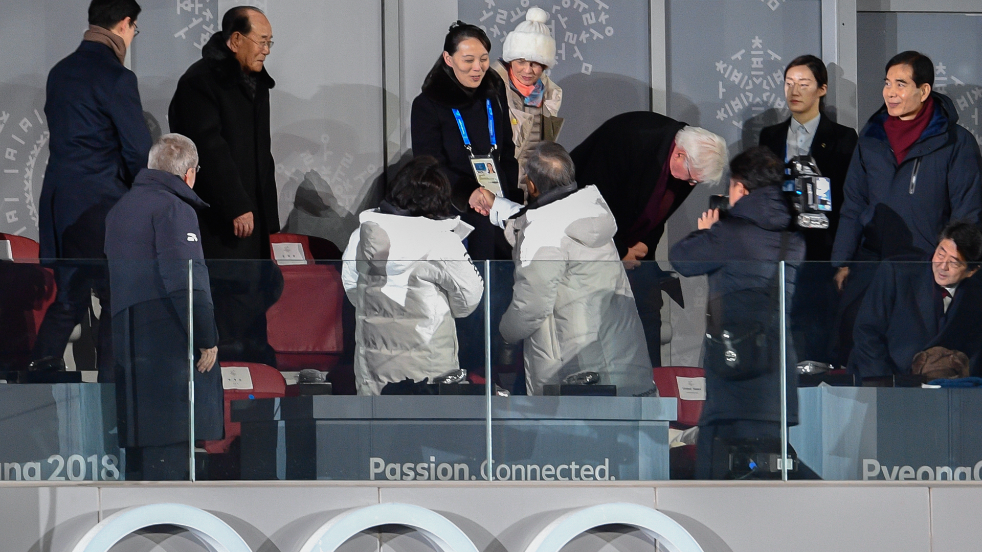 North Korea's Kim Jong Uns sister Kim Yo Jong (C) shakes hand with South Korea's President Moon Jae-in during the opening ceremony of the Pyeongchang 2018 Winter Olympic Games on February 9, 2018. (Credit: MARTIN BUREAU/AFP/Getty Images)
