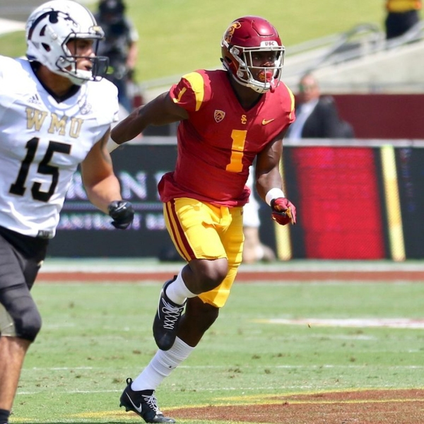 USC freshman receiver Joseph Lewis (1) runs downfield to cover a punt during a game against Western Michigan on Sept. 2. (Credit: Shotgun Spratling / Los Angeles Times)
