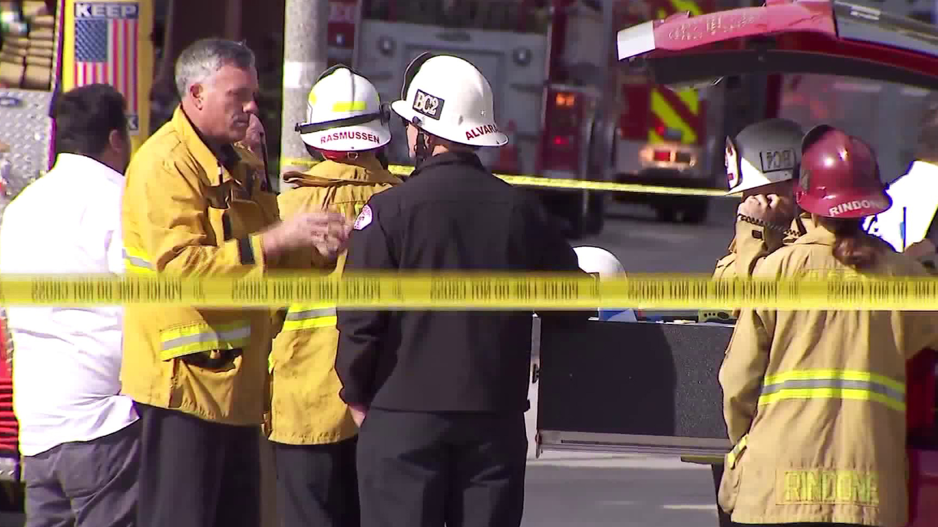 Firefighters and other first responders stand at the scene at Cal State Long Beach, where a chemistry experiment sparked a fire that injured one person on Feb. 27, 2018. (Credit: KTLA)