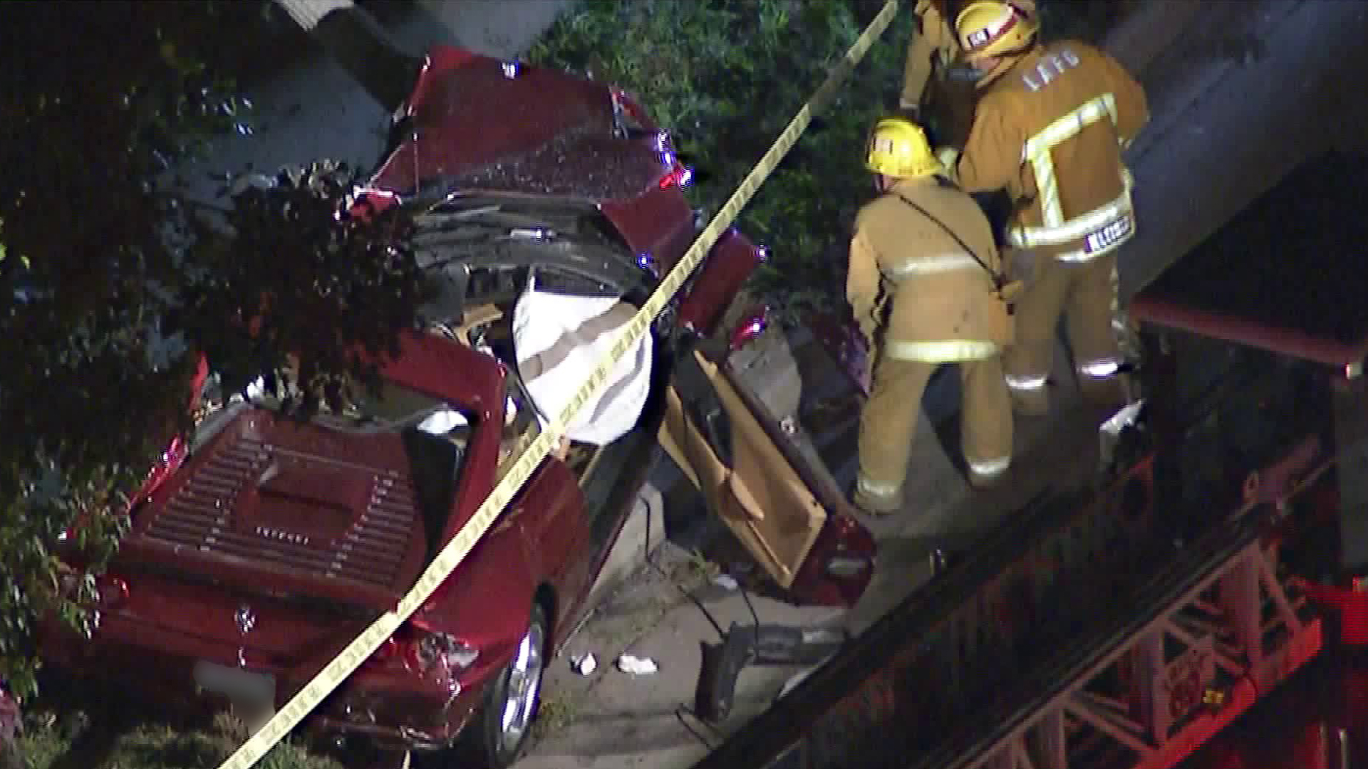 A Ferrari involved in a fatal roll-over crash in Pacific Palisades suffered extensive damage on Feb. 13, 2018. (Credit: KTLA)