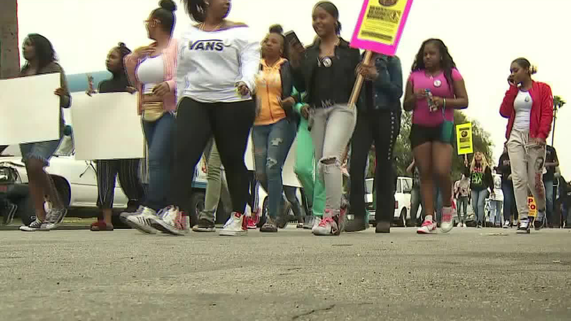 Protestors march in an area of South Los Angeles on Feb. 10, 2018, near where 16-year-old Anthony Weber was shot dead by an L.A. County sheriff's deputy nearly a week earlier, demanding answers in the teen's death. (Credit: KTLA)