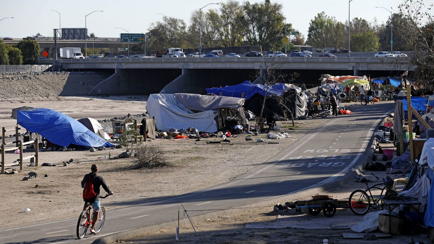 Orange County officials want to clear the county's largest homeless encampment, a tent city along the Santa Ana River in Anaheim and Orange where several hundred people live as of early 2018. (Credit: Gary Coronado / Los Angeles Times)