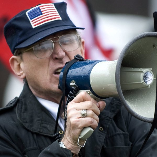 Arthur Jones shouts into a bullhorn during a protest at the dedication ceremony for the Illinois Holocaust Museum and Education Center in Skokie, Illinois, in April 2009. (Credit: Tannen Maury/EPA/REX/Shutterstock)