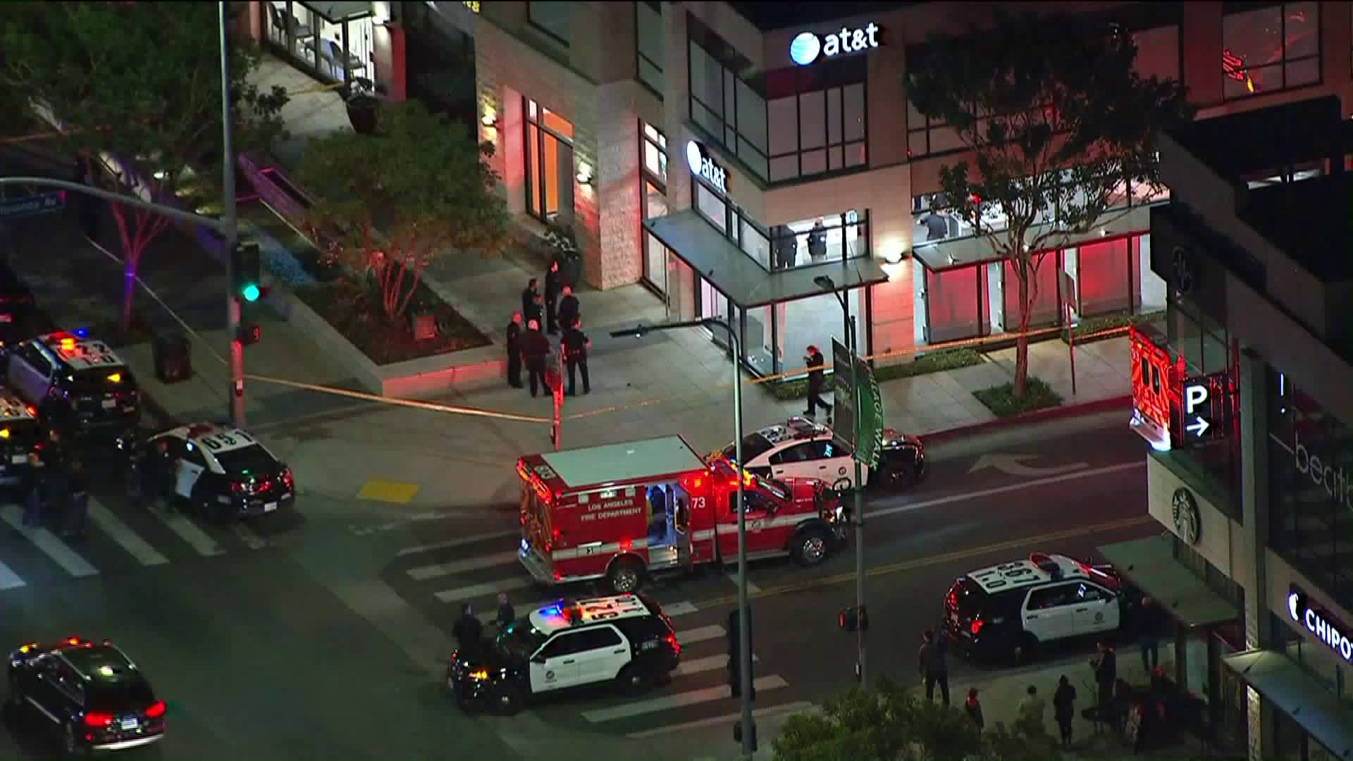 Paramedics and police respond to an officer needs help call at an AT&t Store in Tarzana on Feb. 19, 2018. (Credit: KTLA)