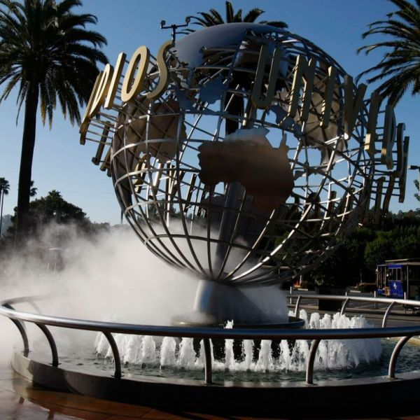 A child runs around the entrance to Universal Studios Hollywood before it opens on March 14, 2013. (Credit: Gary Friedman / Los Angeles Times)