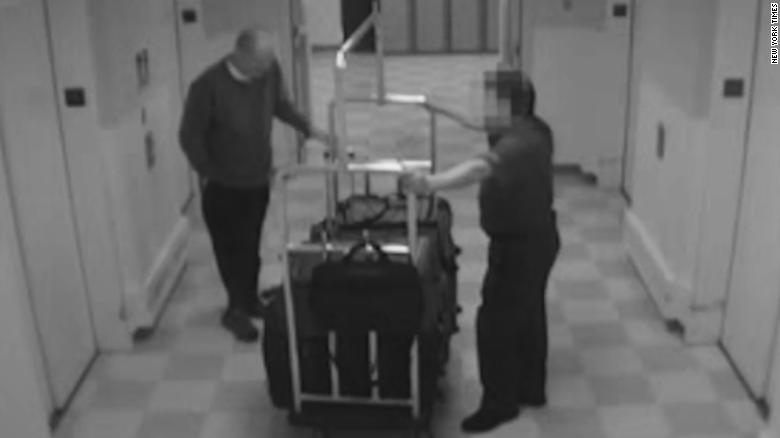 A screengrab from video obtained by The New York Times on March 22, 2018 shows the Las Vegas gunman taking several suitcases to his room at the Mandalay Bay Hotel.