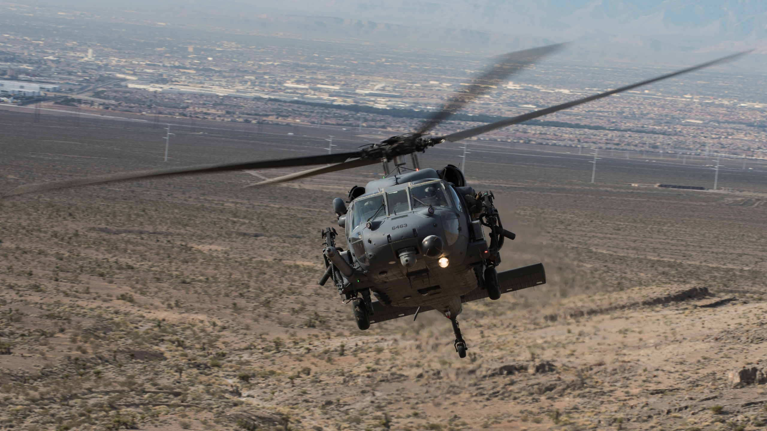 An HH-60G Pave Hawk helicopter assigned to the 66th Rescue Squadron flies during training on Nellis Air Force Base, Nevada, Feb. 22, 2018. (Credit: U.S. Air Force / Senior Airman Kevin Tanenbaum)