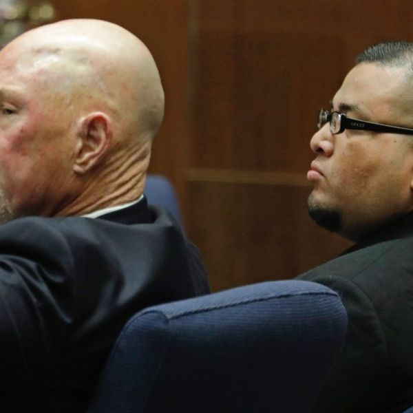 Jorge Palacios, right, sits with lawyer Lawrence Forbes during closing arguments in his trial on March 1, 2018. (Credit: Myung J. Chun / Los Angeles Times)