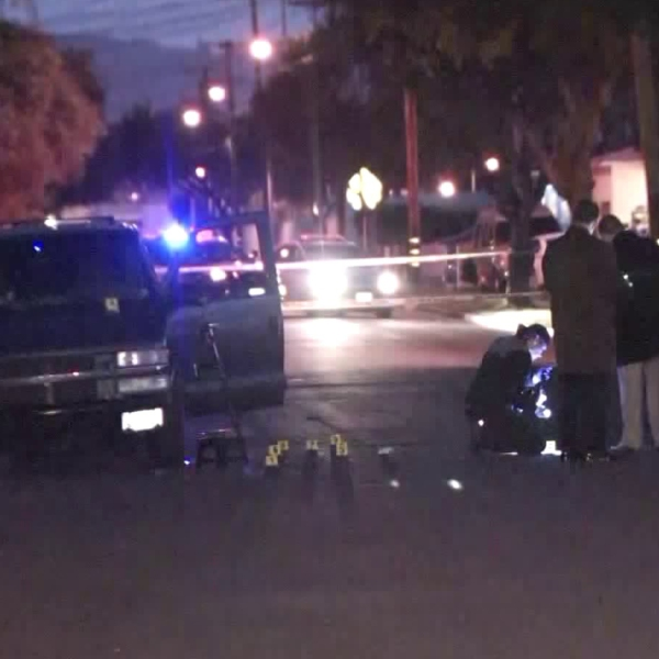 Police investigate a fatal shooting in Bell on March 5, 2018. (Credit: KTLA)