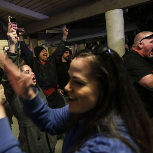 """Spectators cheer the Los Alamitos City Council's vote to oppose California's """"sanctuary"""" state law. (Robert Gauthier / Los Angeles Times)"""
