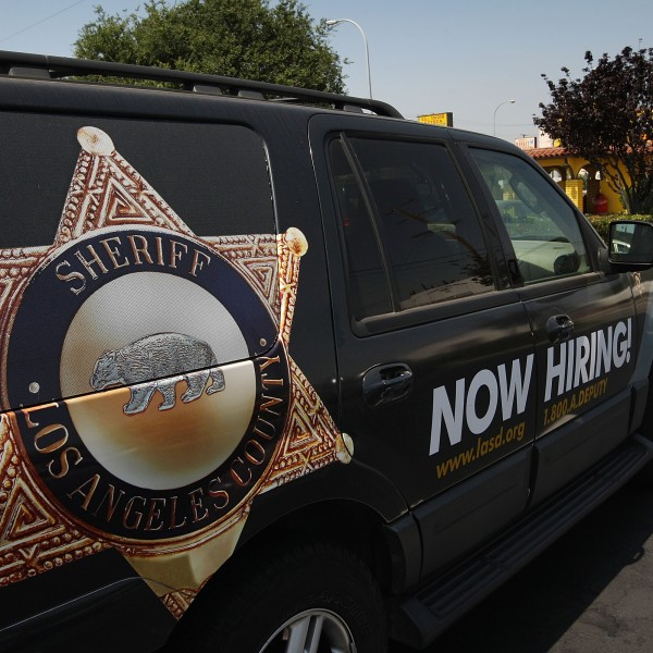 A Los Angeles County sheriff's vehicle that advertises for recruits is parked in the parking lot of the Maywood Police Department as deputies make plans to take over the facility on June 23, 2010. (Credit: David McNew/Getty Images)