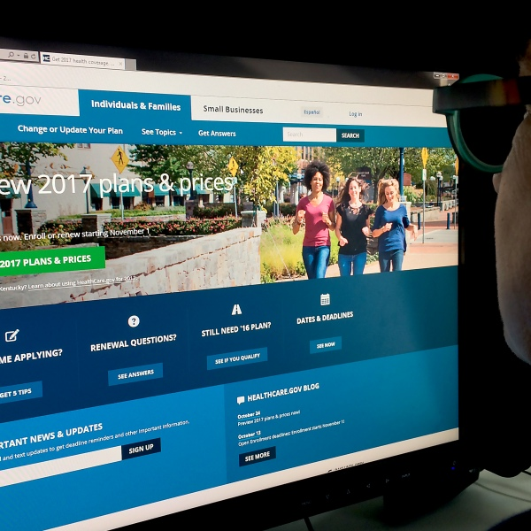 This Oct. 25, 2016, photo shows a woman looking at the Healthcare.gov website. (Credit: Karen Bleier / AFP / Getty Images)