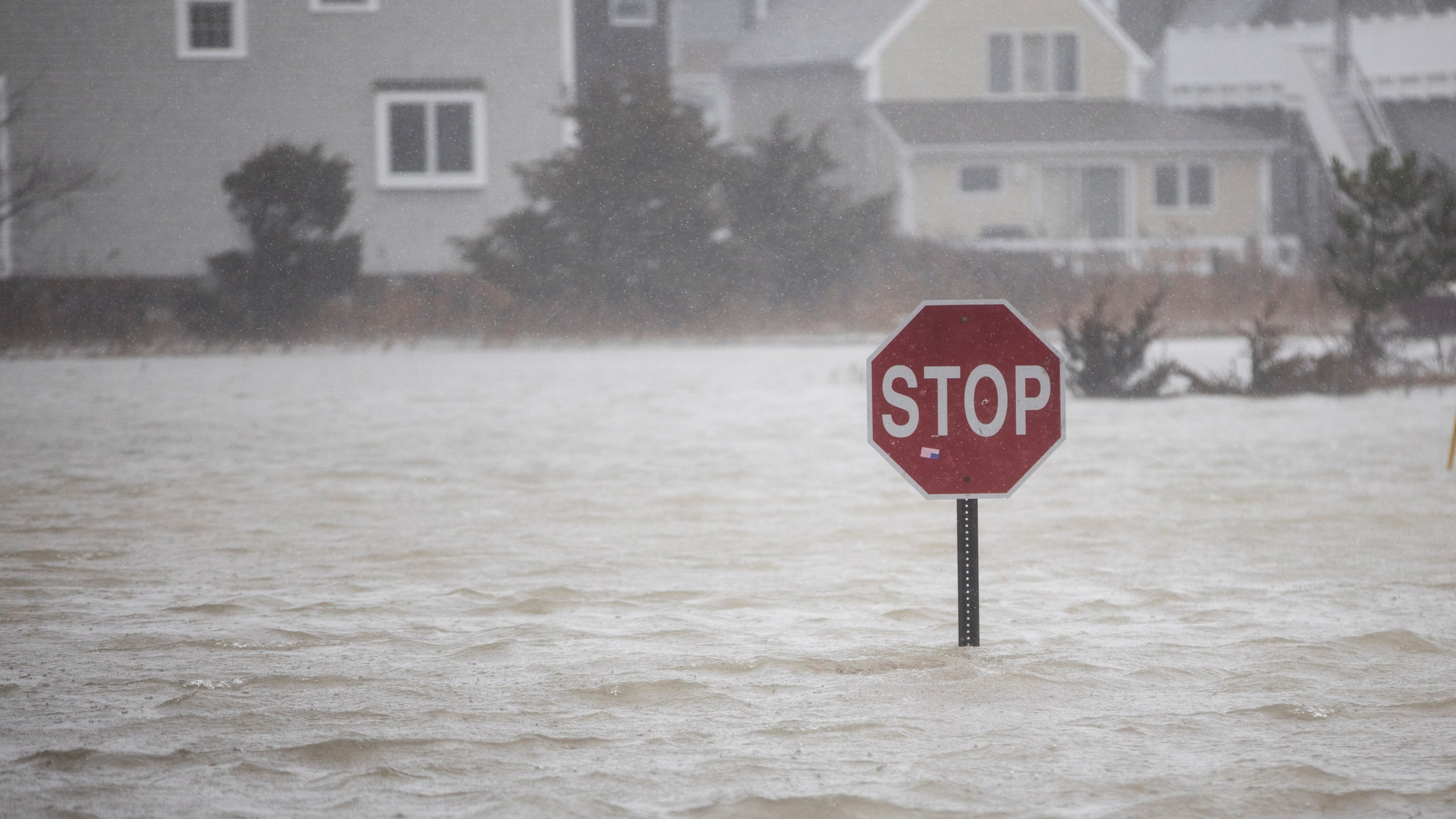 A flooded out road with a stop sign as a large coastal storm bears down on the region on March 2, 2018 in Scituate, Massachusetts. (Credit: Scott Eisen/Getty Images)