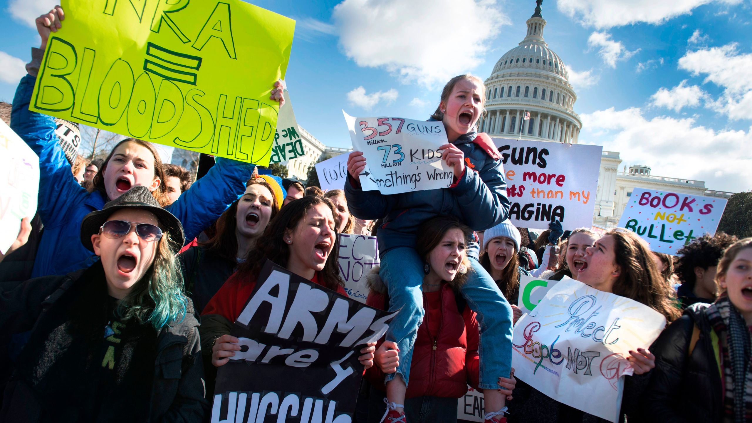 """Students participate in a rally on Capitol Hill with other students from DC, Maryland and Virginia in their Solidarity Walk-Out to urge Republican leaders in Congress """"to allow votes on gun violence prevention legislation,"""" March 14, 2018. (Credit: Jim Watson / AFP / Getty Images)"""