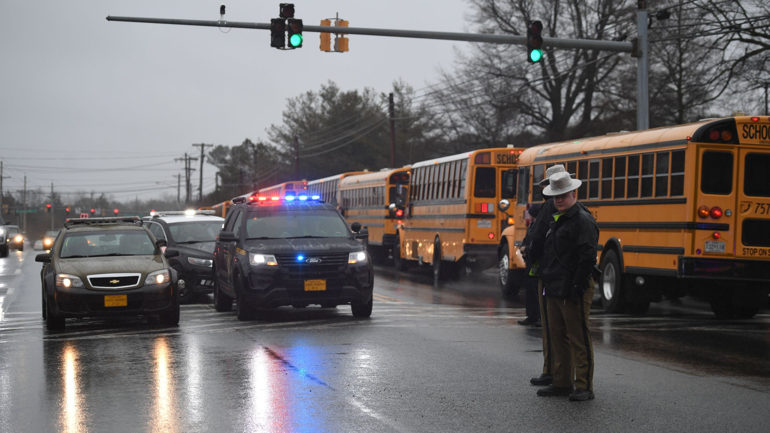 School buses, security and State Troopers are seen on March 20, 2018 at Great Mills High School in Great Mills, Maryland after a shooting at the school. (Credit: JIM WATSON/AFP/Getty Images)
