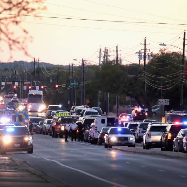 Police respond after one person was injured by a package containing an incendiary device at a nearby Goodwill store on March 20, 2018 in Austin, Texas. (Credit: Scott Olson/Getty Images)