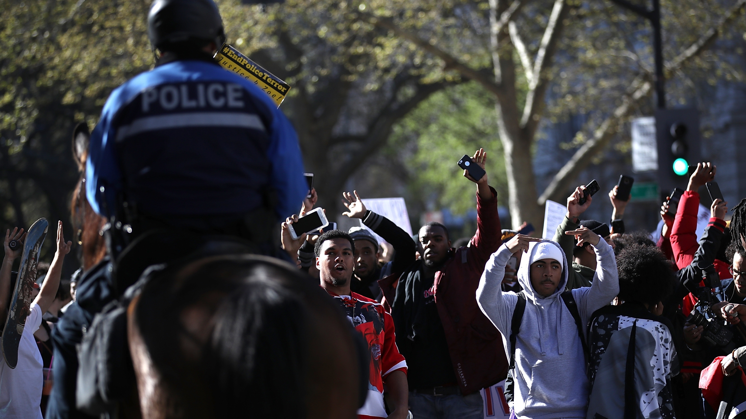 Black Lives Matter protesters gesture towards a Sacramento police officer during a demonstration on March 22, 2018. Hundreds of protesters staged a demonstration after two officers shot and killed Stephon Clark, an unarmed black man, in the backyard of his grandmother's house. (Credit: Justin Sullivan/Getty Images)