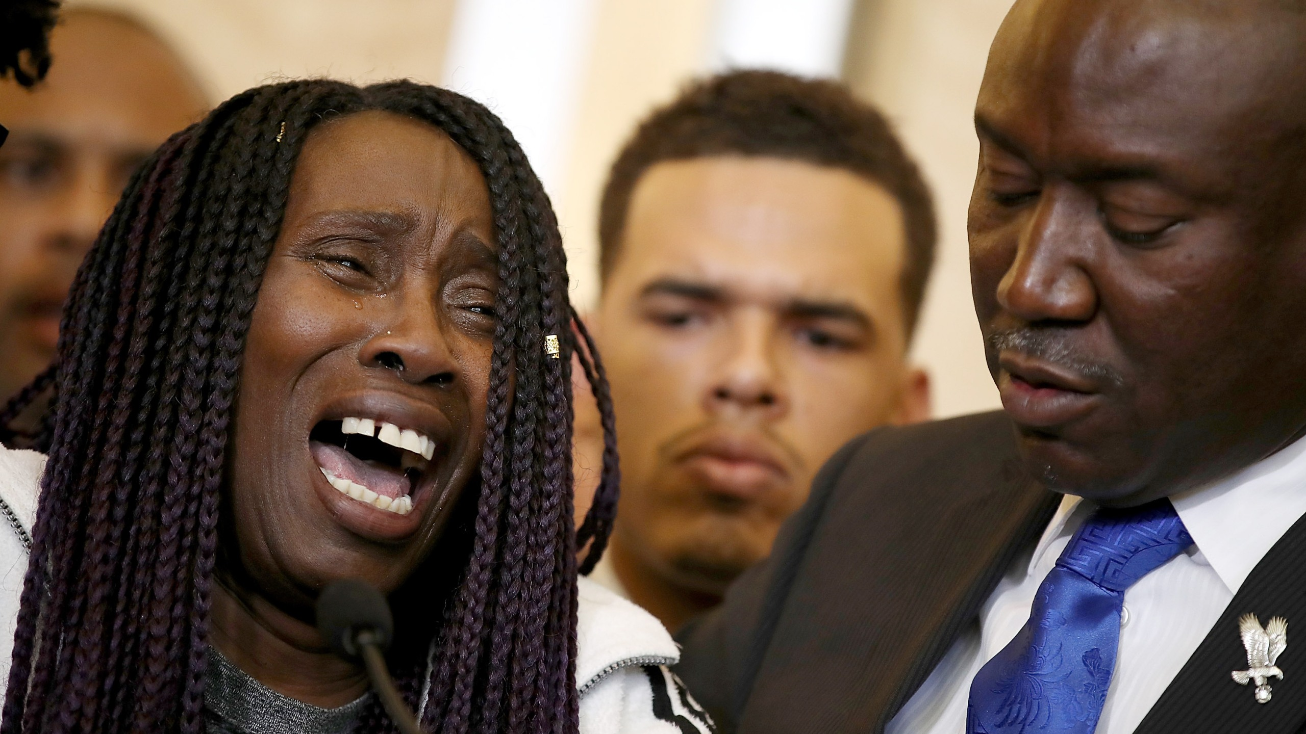 Sequita Thompson, left, grandmother of Stephon Clark, who was shot and killed by Sacramento police, cries as she speaks during a news conference with civil rights attorney Ben Crump on March 26, 2018, in Sacramento. (Credit: Justin Sullivan / Getty Images)