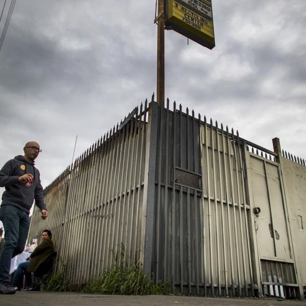This undated photo shows a man walking by a lot that was slated for a homeless housing project in the 400 block of East Florence Avenue in Los Angeles. (Credit: Gina Ferazzi / Los Angeles Times)