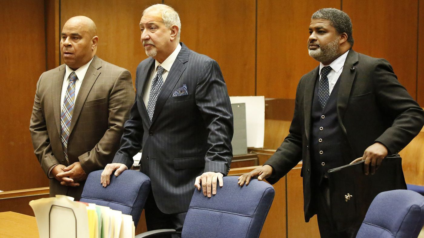 "Attorney Matthew Fletcher, left, represented by Mark J. Geragos, center, and attorney Thaddeus Culpepper appear in court as they were indicted on charges of conspiring to bribe potential witnesses in the pending murder case of former rap mogul Marion ""Suge"" Knight on March 16, 2018. (Credit: Al Seib / Los Angeles Times)"