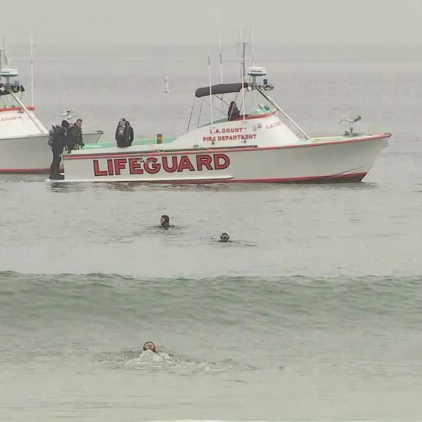 Lifeguards search for a missing person near the Santa Monica Pier on March 10, 2018. (Credit: KTLA)
