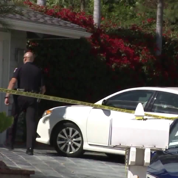 Two dead bodies were found inside a home in Orange, where detectives are seen investigating the scene later that same day on March 14, 2018. (Credit: KTLA)