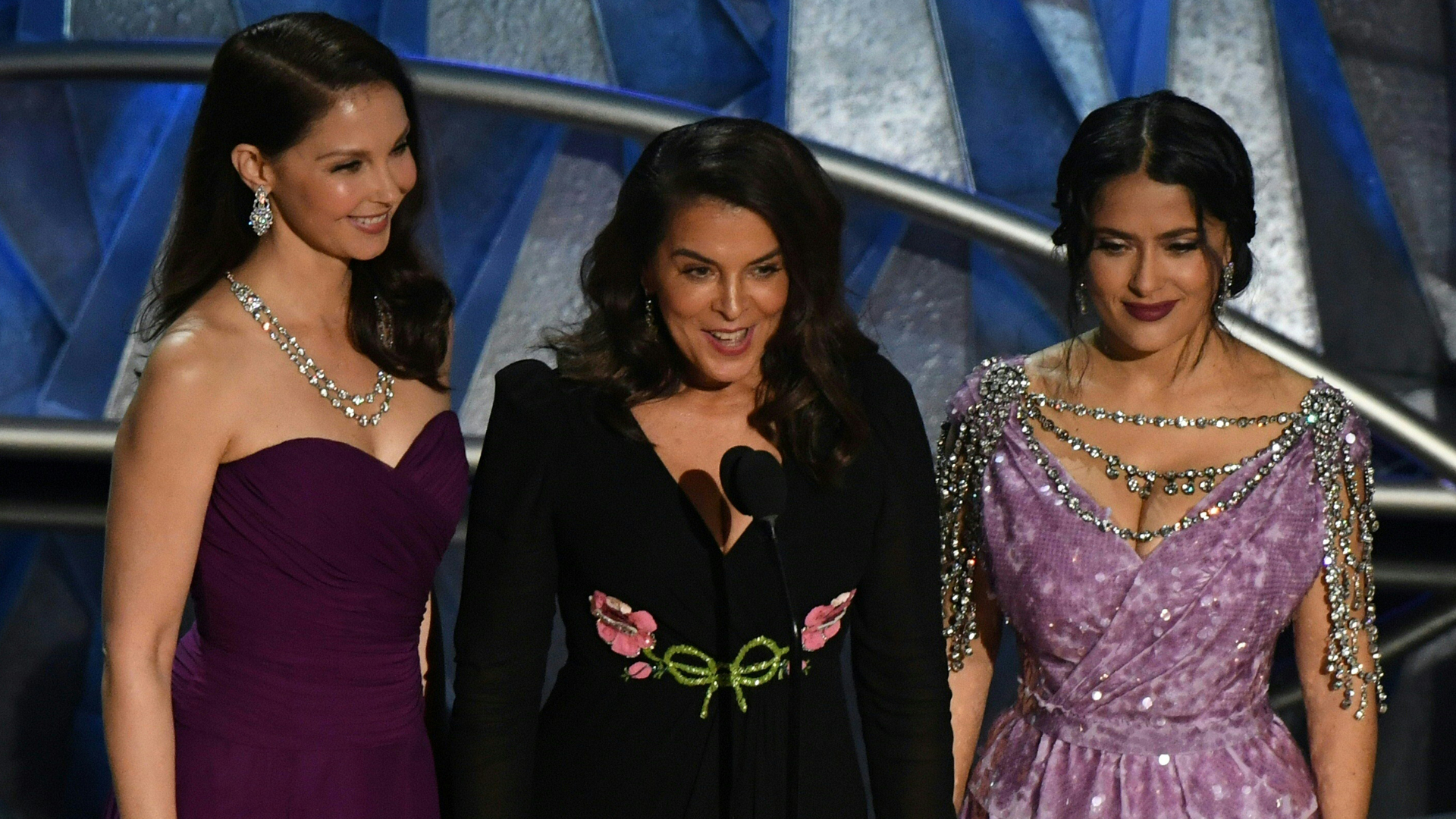 Actress Ashley Judd, Italian-American actress Annabella Sciorra and Mexican-Lebanese actress Salma Hayek deliver a speech about sexual harassment in the entertainment industry during the 90th Annual Academy Awards show on March 4, 2018, in Hollywood. (Credit: Mark Ralston/AFP/Getty Images)