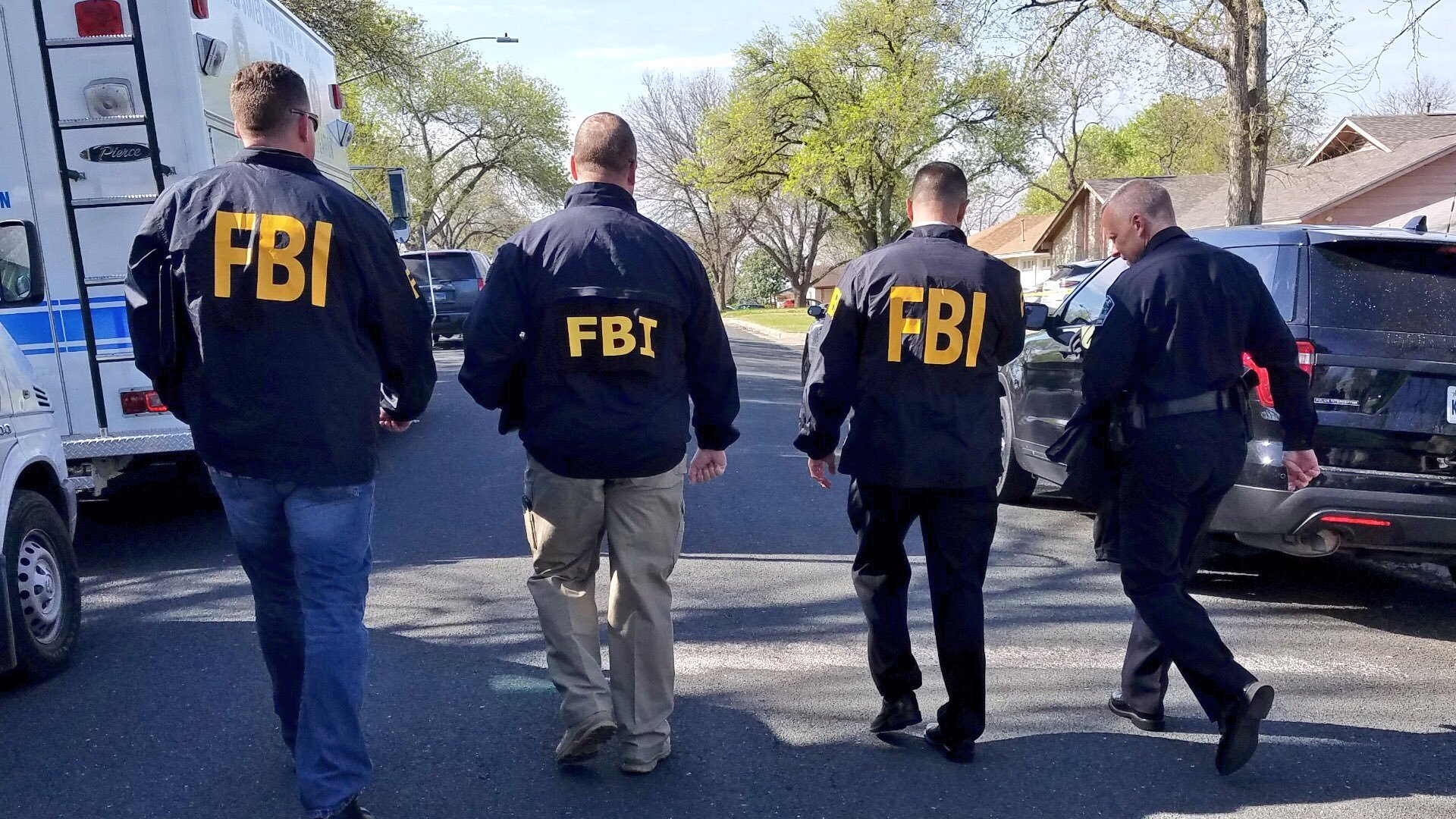 Law enforcement officials investigate on March 12, 2018, after a series of bombs were delivered to Austin homes, killing at least one. (Credit: Austin Police Department)