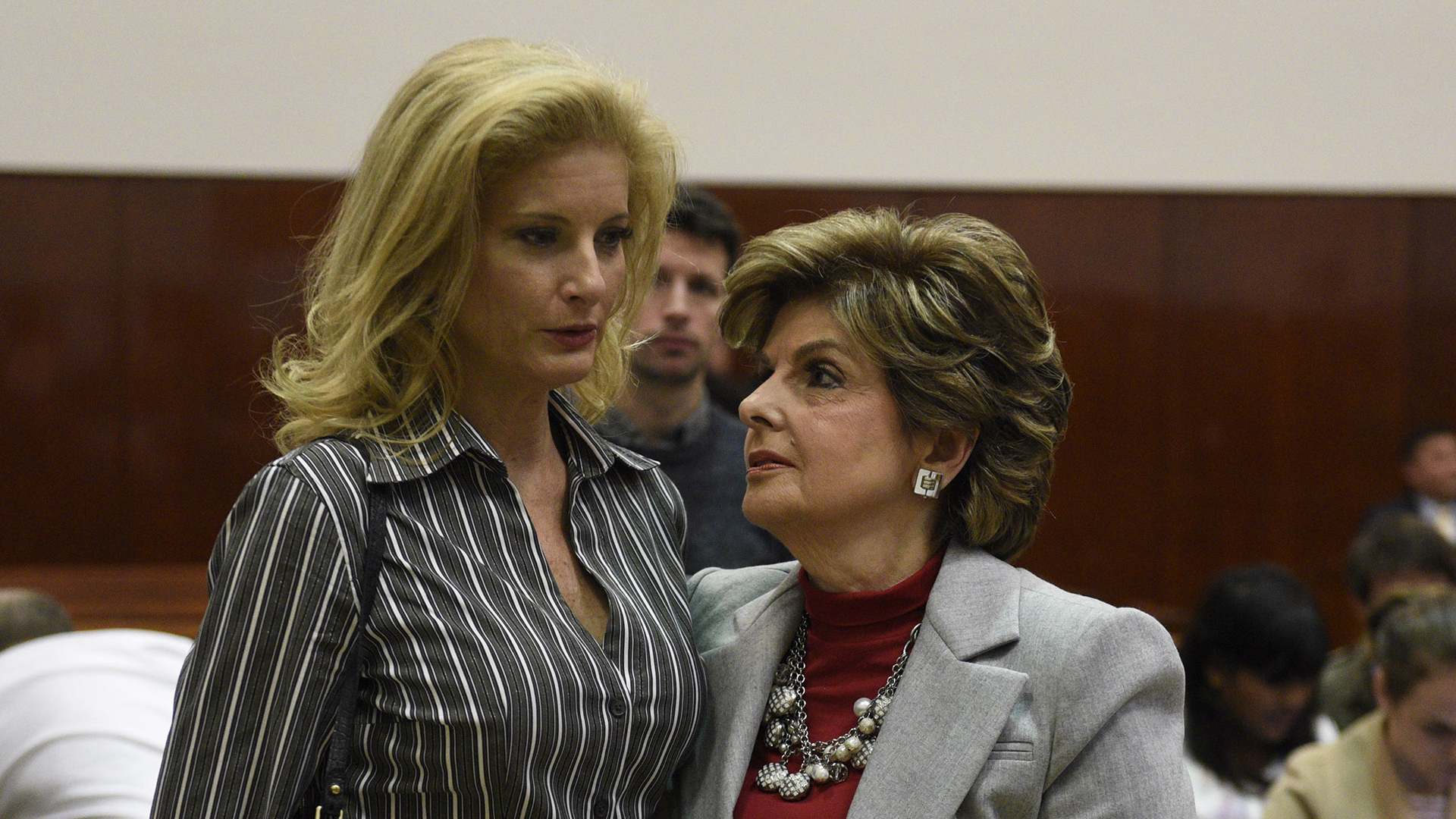 """Summer Zervos, left, a former contestant on """"The Apprentice,"""" listens to her lawyer Gloria Allred in New York County Criminal Court on Dec. 5, 2017, in New York. (Credit: BARRY WILLIAMS/AFP/Getty Images)"""