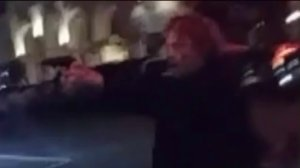 A still from a cellphone video provided to KTLA shows a man brandishing a firearm outside the Surfside bar in Venice.