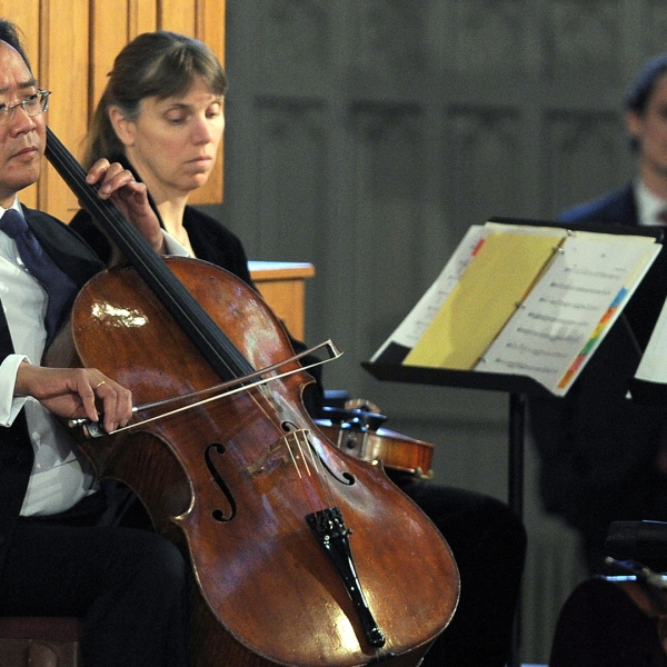 "Musician Yo-Yo Ma performs during ""Healing Our City: An Interfaith Service"" dedicated to those who were gravely wounded or killed in the Boston Marathon bombing, at the Cathedral of the Holy Cross in Boston, Mass., on April 18, 2013. (Credit: JEWEL SAMAD/AFP/Getty Images)"