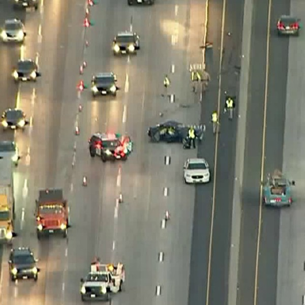Officers respond to a crash on the 91 Freeway in the Buena Park area on April 17, 2018. (Credit: KTLA)