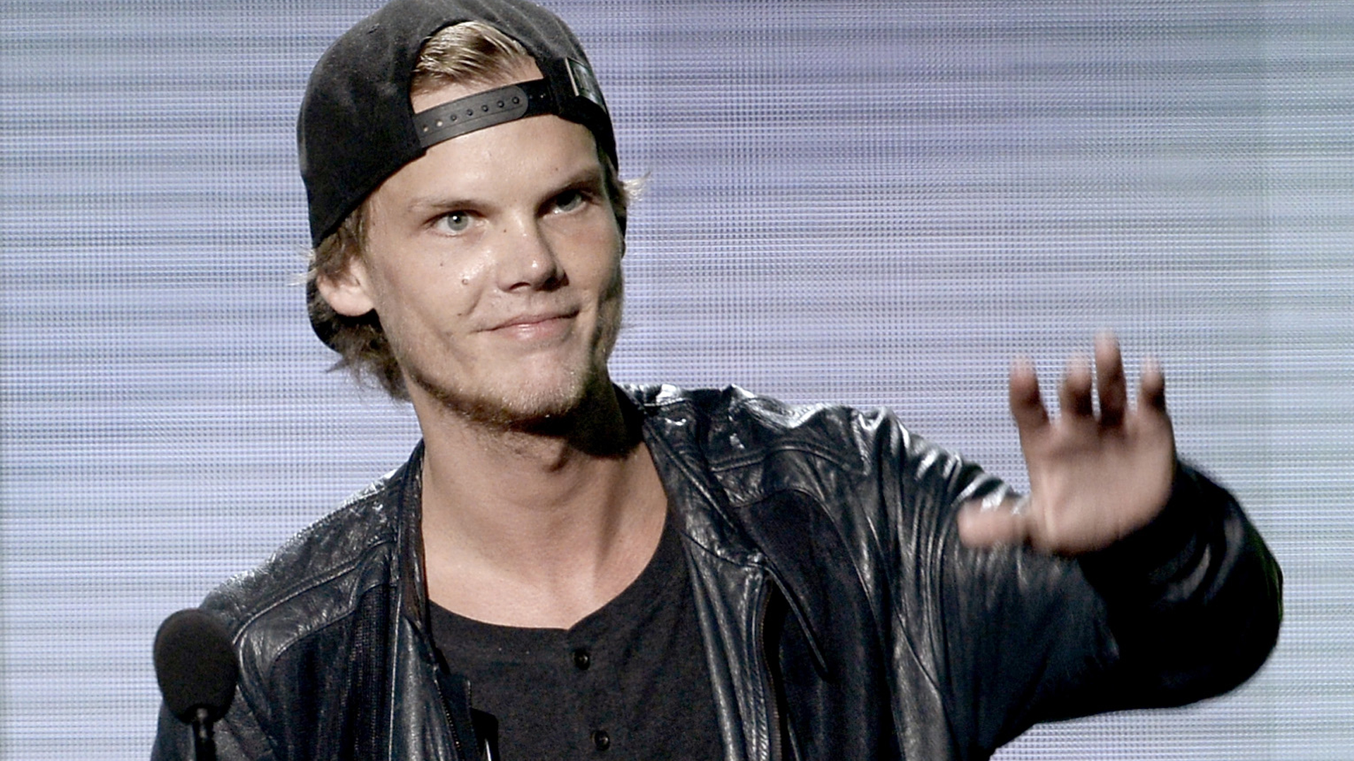 Musician Avicii accepts the Favorite Electronic Dance Music Artist award onstage during the 2013 American Music Awards at Nokia Theatre L.A. Live on November 24, 2013 in Los Angeles, California. (Credit: Kevin Winter/Getty Images)