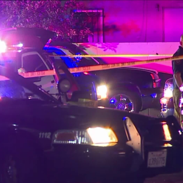 Police respond to a call about a gunshot victim in the 5000 block of Gage Avenue in Bell on April 22, 2018. (Credit: Loudlabs/KTLA)