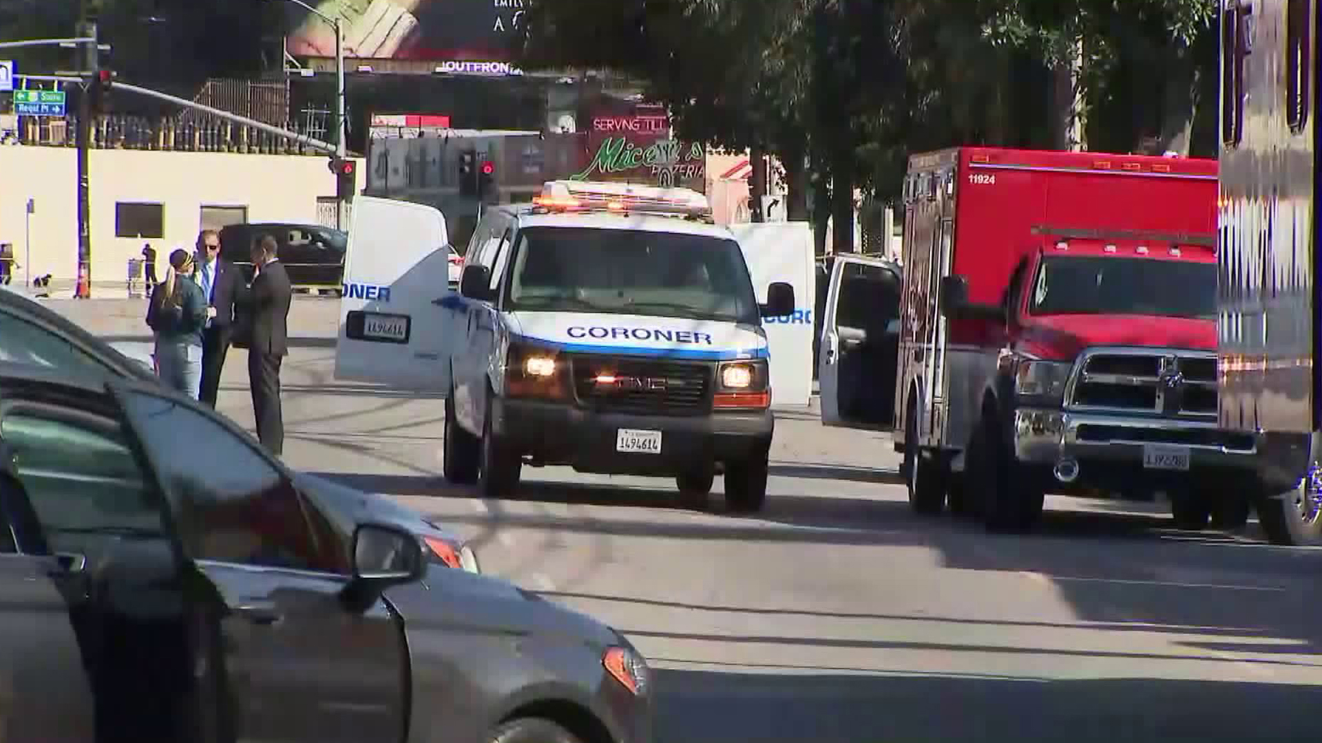 A coroner's van arrives at the scene of a fire that left two dead in Studio City on April 14, 2018. (Credit: KTLA)
