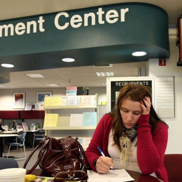 A woman fills out paperwork at an employment center in this file photo. (Credit: KTLA)