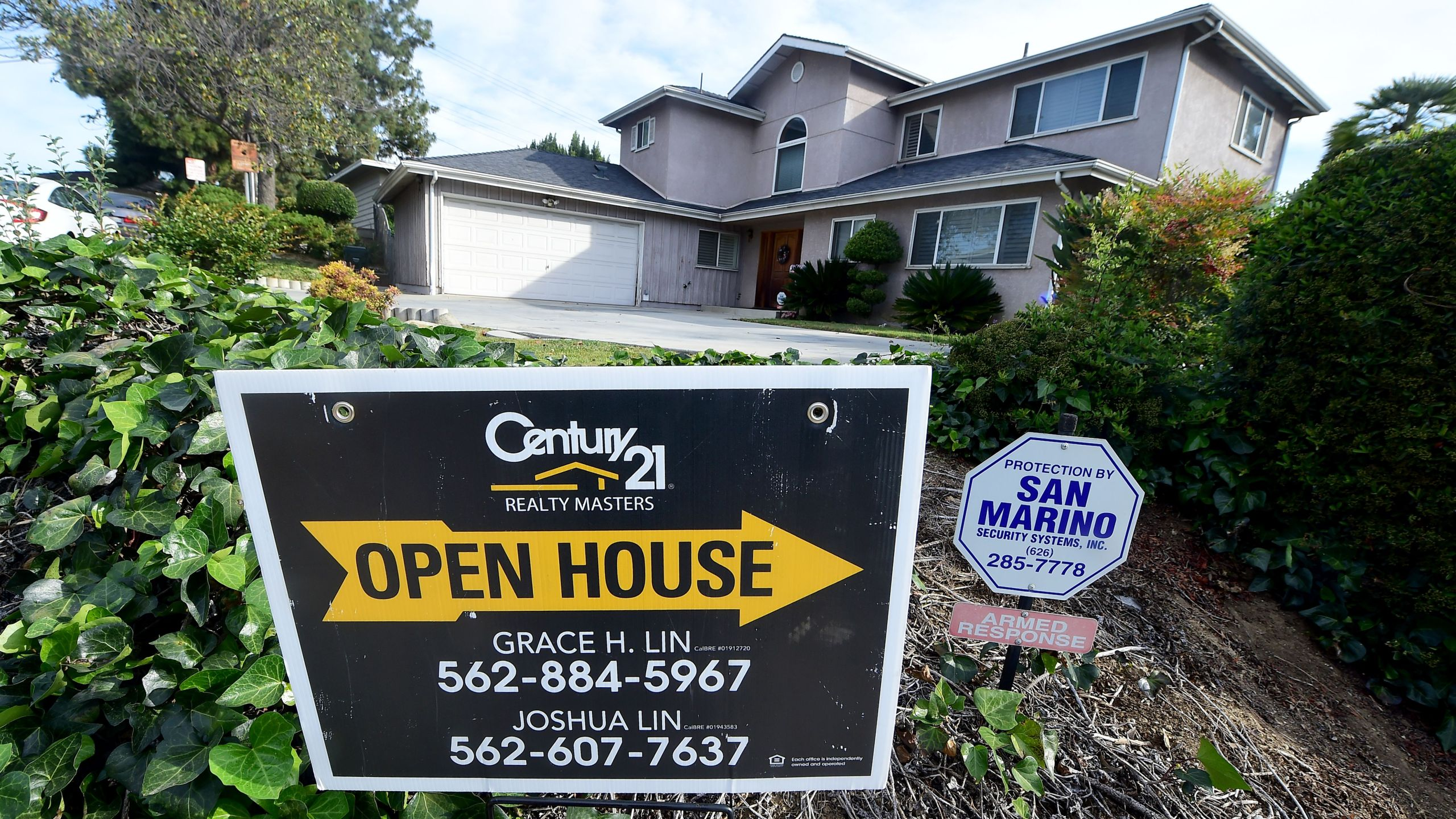 An open house sign directs prospective buyers to property for sale in Monterey Park on April 19, 2016. (Credit: Frederic J. Brown / AFP / Getty Images)