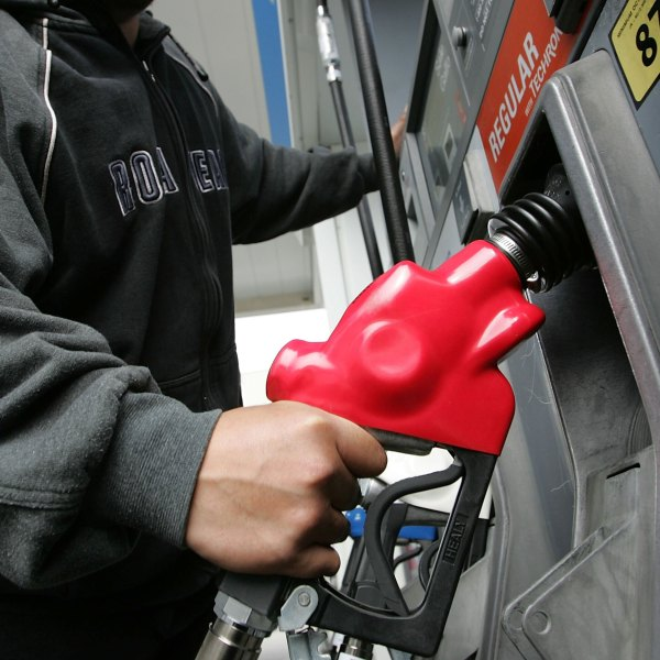 Don Resuerco holds a gas pump before pumping gas into his work van March 27, 2006 in San Francisco. (Credit: Justin Sullivan/Getty Images)