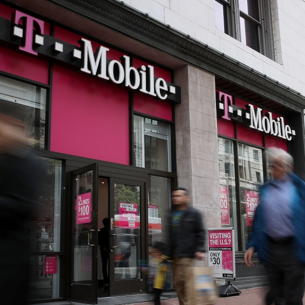 Pedestrians walk by a T-Mobile store in San Francisco on on April 24, 2017. (Credit: Justin Sullivan/Getty Images)