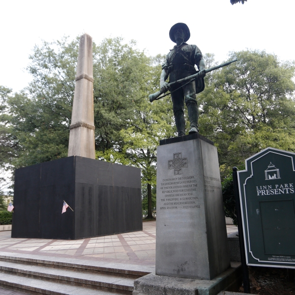 A monument to volunteers of the Army of the Republic stands next to a confederate monument covered up by the mayor of Birmingham in Linn Park August 18, 2017 in Birmingham, Alabama. (Credit: Hal Yeager/Getty Images)