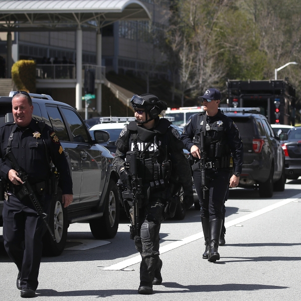 Police walk outside of the YouTube headquarters on April 3, 2018 in San Bruno, California. (Credit: Justin Sullivan/Getty Images)