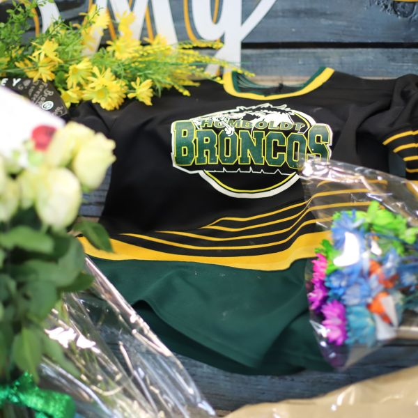 An ice hockey jersey is left in a makeshift memorial at the Humboldt Uniplex in Humboldt, Canada, on April 8, 2018. (Credit: KYMBER RAE/AFP/Getty Images)