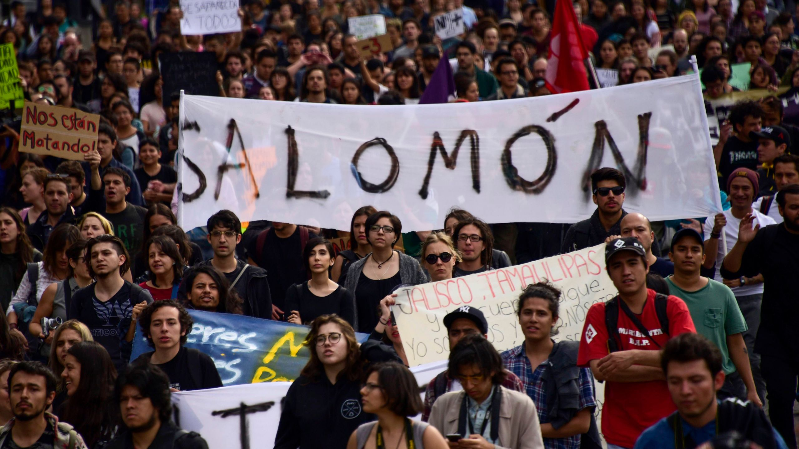 Mexican students take part in a protest against the violence in Mexico and the murder of three students from the University of Audiovisual Media of Guadalajara, in Mexico City, on April 24, 2018. (Credit: Pedro Pardo / AFP / Getty Images)