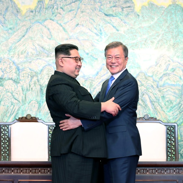 North Korean leader Kim Jong Un and South Korean President Moon Jae-in embrace after signing the Panmunjom Declaration for Peace, Prosperity and Unification of the Korean Peninsula on April 27, 2018. (Credit: Korea Summit Press Pool/Getty Images)