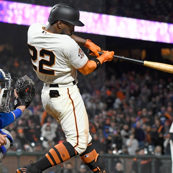 Andrew McCutchen #22 of the San Francisco Giants hits a walk-off three-run homer to defeat the Los Angeles Dodgers 7-5 in the bottom of the 14th inning at AT&T Park on April 7, 2018. (Credit: Thearon W. Henderson/Getty Images)