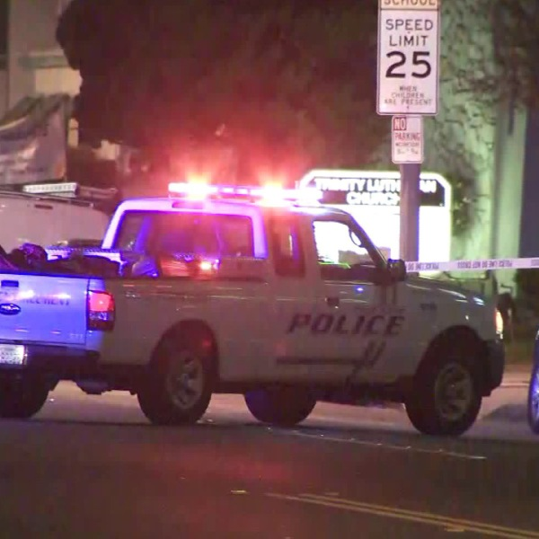 A police vehicle is seen in Hawthorne where a woman was fatally struck by a car on April 29, 2018. (Credit: KTLA)