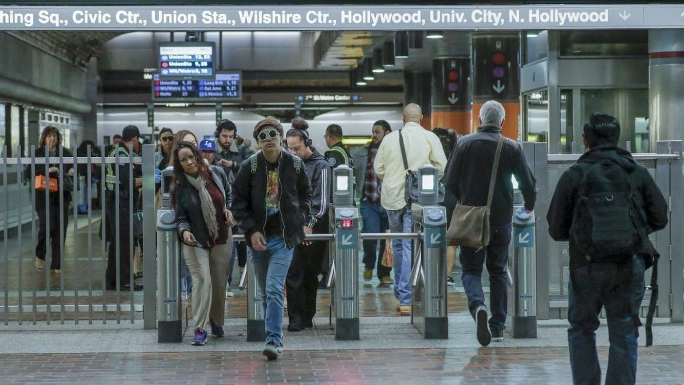 Commuters make their way through turnstiles at the 7th Street and Metro Center station in downtown L.A. (Credit: Irfan Khan / Los Angeles Times)