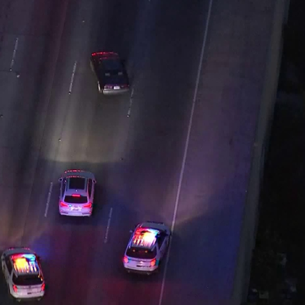 Authorities chase a Toyota Camry on the southbound 405 Freeway in the West L.A. area on April 12, 2018. (Credit: KTLA)