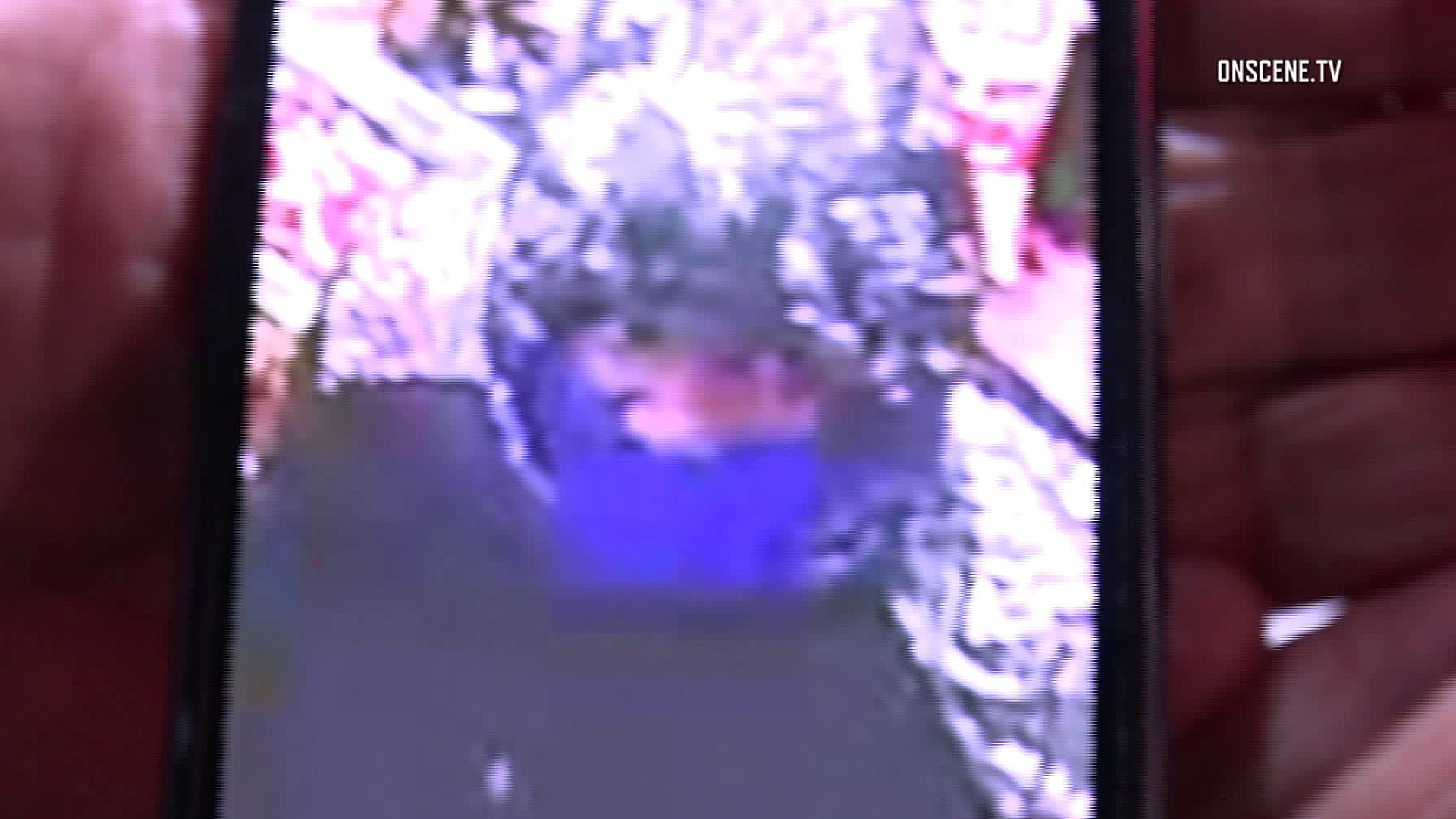 An armed robber at a Cypress 7-Eleven is seen in a surveillance image provided on April 25, 2018.