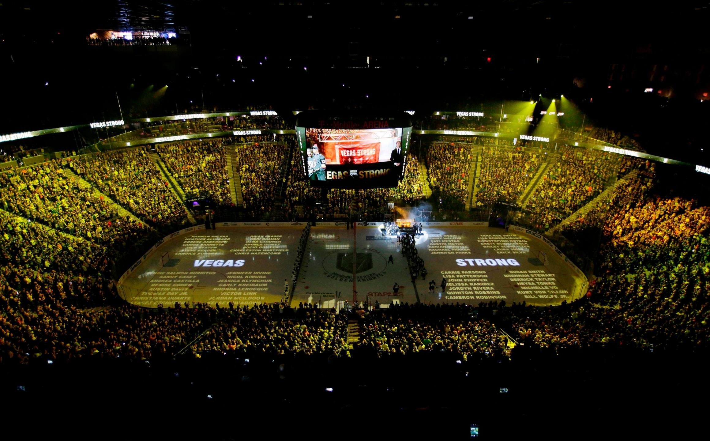 The names of people killed during the mass shooting in Las Vegas last year are projected on the ice during a ceremony before an NHL hockey game between the Vegas Golden Knights and the San Jose Sharks on Saturday in Las Vegas. (Credit: John Loocher/AP)